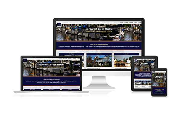 Northwest Creek Marina's new mobile responsive website design displayed on a phone, desktop, laptop, and tablet
